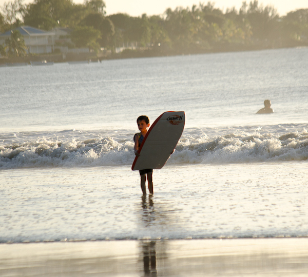 Catch your first waves on Tamarin Bay